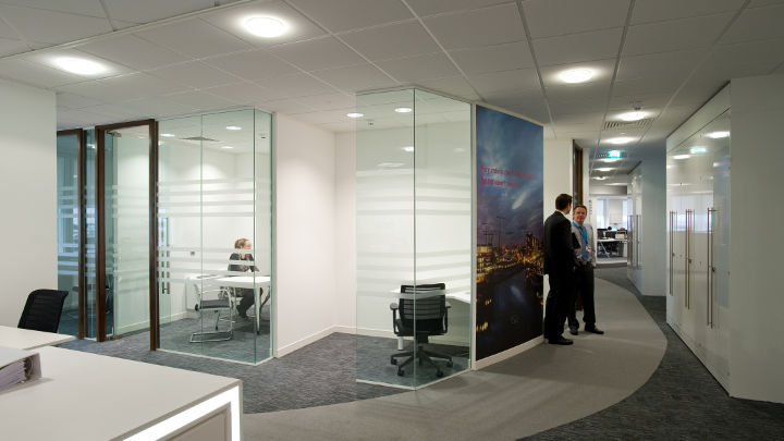 The corridor of Manchester Airport Olympic House illuminated by Philips led office lighting.