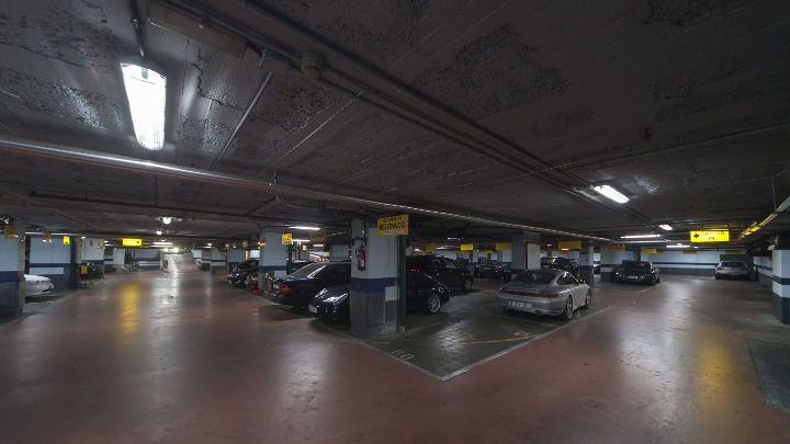 Cars parked by the light of Philips' lighting at NH Hoteles car park