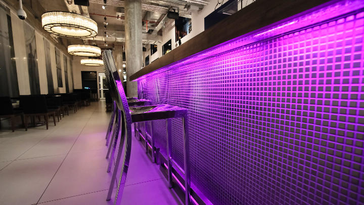 Bar lighting at Some Place Else with iColor Cove by Philips Lighting