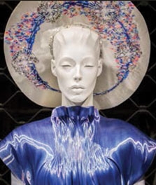 A mannequin wears a blue dress, which is color-enhanced by Philips LED flavors