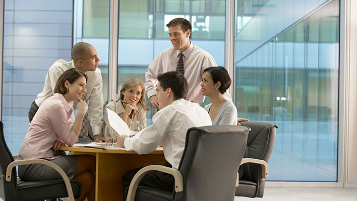 Business people are discussing about a project on a table